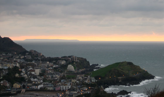 Lundy Island seen rising out of the sea from Ilfracombe, Devon